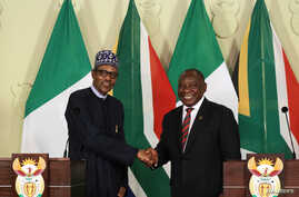 Nigeria's President Muhammadu Buhari shakes hands with his South African counterpart Cyril Ramaphosa during a news conference after a meeting, in Pretoria, South Africa, Oct. 3, 2019.