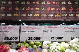 Various types of fruit are on display at a Vietnamese supermarket. Many consumers are switching to ready-to-eat, processed foods instead of relying on their traditional, plant-heavy diets. (H. Nguyen/VOA)