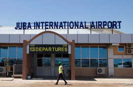 A man walks in front of the departure gate of the new terminal building at Juba International Airport in Juba, South Sudan, on…