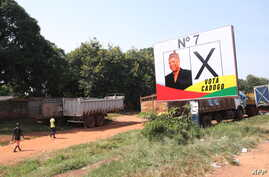 Presidential election campaign posters are seen on a billboard in Bissau, November 8, 2019. (Photo by - / AFP)