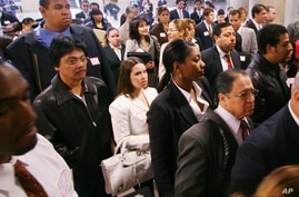 Attendees to a job fair sponsored by the Hispanic Alliance for Career Enhancement file into the Jacob Javits Convention Center…