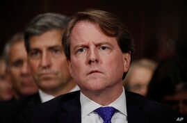 White House counsel Don McGahn listens as Supreme Court nominee Brett Kavanaugh testifies before the Senate Judiciary Committee.