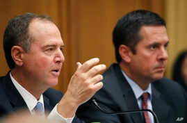 House Intelligence Committee Chairman Adam Schiff, D-Calif., questions former special counsel Robert Mueller as he testifies…
