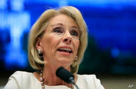 FILE - In this April 10, 2019 file photo, Education Secretary Betsy DeVos testifies before the House Education and Labor…