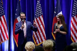 Donald Trump, Jr., left, and Trump campaign senior advisor Kimberly Guilfoyle, right, speak to supporters of President Donald Trump during a panel discussion, Oct. 15, 2019, in San Antonio.