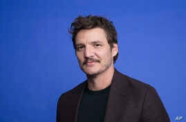"""This Oct. 19, 2019 photo shows Pedro Pascal at the Disney Plus launch event promoting """"The Mandalorian"""" at the London West…"""