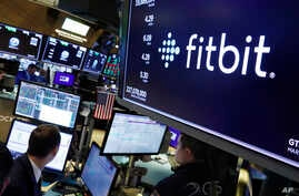 The logo for fItbit appears above a trading post on the floor of the New York Stock Exchange, Monday, Oct. 28, 2019. (AP Photo…