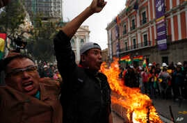 Opponents of Bolivia's President Evo Morales celebrate after he announced his resignation in La Paz, Bolivia, Nov. 10.