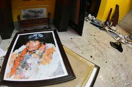 A broken portrait of former Bolivia's President Evo Morales is on the floor of his private home in Cochabamba, Bolivia, after…