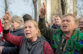 Supporters of the government shout slogans outside Moldova's parliament during a rally in Chisinau, Moldova, Nov. 12, 2019.