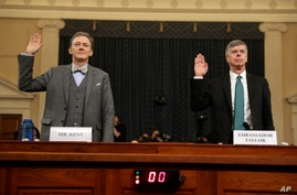 Career Foreign Service officer George Kent and top U.S. diplomat in Ukraine William Taylor, right, are sworn in to testify…
