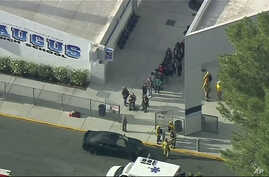 People are lead out of Saugus High School after reports of a shooting, Nov. 14, 2019 in Santa Clarita, California.