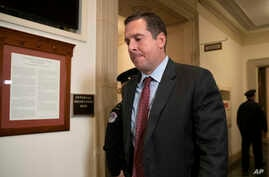 House Intelligence Committee ranking member Rep. Devin Nunes, R-Calif., leaves Capitol Hill as the second public impeachment…