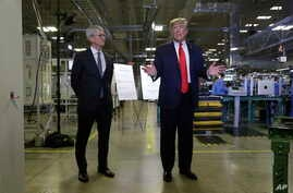 Apple CEO Tim Cook and President Donald Trump speak during a tour of an Apple manufacturing plant, Wednesday, Nov. 20, 2019, in Austin.