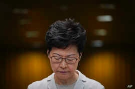 Hong Kong Chief Executive Carrie Lam reacts during a press conference in Hong Kong, Nov. 26, 2019.