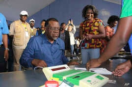 Namibian President Hage Geingob prepares to cast his vote in Windhoek, Namibia, in the country's elections, Nov. 27, 2019.