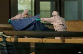 Police forensic officers work where a man was killed on London Bridge following an incident in London, Friday, Nov. 29, 2019…