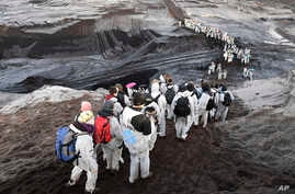 Supporters of the climate movement Ende Gelaende protest at the coal-fired power station Lippendorf near Leipzig, Germany, Nov. 24, 2019.