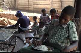 Orphans in Harare's Kambuzuma township eat a meal provided by the charity Faith Community Support, Nov. 28, 2019. (Columbus Mavh