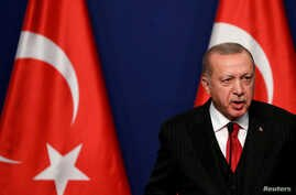FILE PHOTO: Turkish President Recep Tayyip Erdogan attends a news conference with Hungarian Prime Minister Viktor Orban (not…