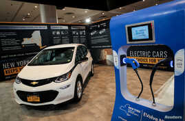 FILE PHOTO: An official New York State electric car is displayed in a New York State exhibit at the 2019 New York International…