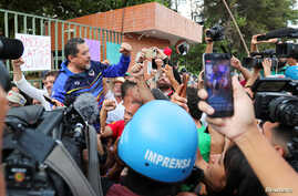 Freddy Meregote, Charge d'affaires at the Venezuelan embassy in Brasil representing Nicolas Maduro's government, gestures as he…