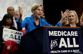 "FILE PHOTO: Senator Elizabeth Warren (D-MA) speaks during an event to introduce the ""Medicare for All Act of 2017"" on Capitol…"