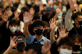 Protesters hold up their hands during an anti-government protest at Yoho Mall in Yuen Long, Hong Kong, China November 21, 2019…