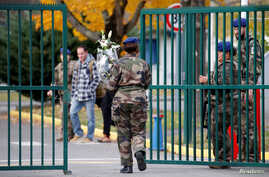 A French soldier arrives with flowers at the 5th Combat Helicopter Regiment (5th RHC) base in Uzein near Pau, France, November…
