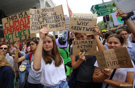 Student activists from School Strike for Climate Australia (SS4C) hold a 'Solidarity Sit-down' outside of the office of the…