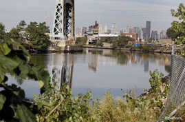 The Newtown Creek is seen in the Queens Borough of New York September 29, 2010. Newtown Creek is a waterway approximately 3.5…