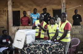 Election officials start counting votes at a polling station in the Bairro Militar area of the capital Bissau, in Guinea-Bissau, Nov. 24, 2019.