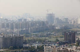 A general view taken from western Tehran shows a blanket of brown-white smog covering the city as heavy pollution hit the Iranian capital, Nov. 13, 2019.