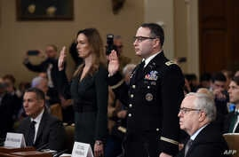 Jennifer Williams, a top aide to Vice President Mike Pence, and Lt. Colonel Alexander Vindman, a top National Security Council official, are sworn in to testify as part of the impeachment inquiry , on Capitol Hill in Washington, Nov. 19, 2019.