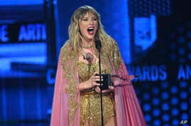 Taylor Swift accepts the award for artist of the decade at the American Music Awards, at the Microsoft Theater in Los Angeles, California, Nov. 24, 2019.