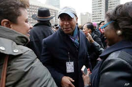 FILE - Former Massachusetts Governor Deval Patrick, center, greets people in a crowd, in Boston, Massachusetts, April 2, 2018.