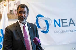 FILE - Director General of Nuclear Energy Agency (NEA) of the Organization for Economic Co-operation and Development (OECD) William D. Magwood holds a press conference in Budapest, Hungary, March 5, 2018.