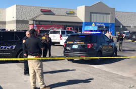 Law enforcement work the scene where two men and a woman were fatally shot, Nov. 18, 2019, outside a Walmart store in Duncan, Oklahoma.