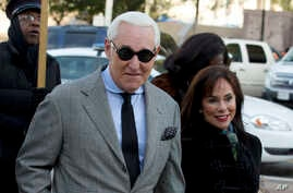 Roger Stone, accompanied by his wife Nydia Stone, arrives at federal court in Washington, Nov. 14, 2019.
