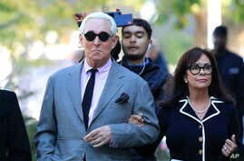Roger Stone, left, with his wife Nydia Stone, arrives at the federal court in Washington, Nov. 5, 2019.