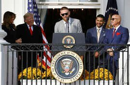 Washington Nationals starting pitcher Stephen Strasburg, center, speaks as First Lady Melania Trump, from left, President Donald Trump, manager Dave Martinez and general manager Mike Rizzo, react at the White House, Nov. 4, 2019, in Washington.