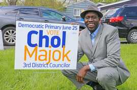 FILE - Chol Majok is seen with a primary election campaign sign in a photo from his Facebook campaign page.