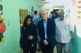 Sudanese health official Iman Mahmoud, left, talks to U.N. humanitarian chief Mark Lowcock, center, during his visit to Kassala, eastern Sudan, Nov. 23, 2019, in a photo posted on Twitter by @UNOCHA_Sudan.