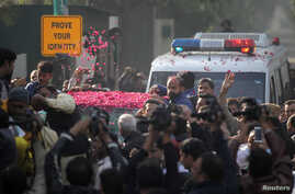 Supporters sprinkle rose petals on a car carrying former Prime Minister Nawaz Sharif, as he makes his way to the airport to travel for a medical treatment in London, outside his residence in Raiwind, near Lahore, Pakistan Nov. 19, 2019.
