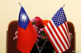 FILE - Flags of Taiwan and the United States are placed on a table before a meeting between Taiwanese and American lawmakers, in Taipei, Taiwan, March 27, 2018.