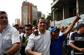 Venezuelan opposition leader Juan Guaido, who many nations have recognised as the country's rightful interim ruler, attends a protest march against Venezuela's President Nicolas Maduro in Caracas, Venezuela, Nov. 16, 2019.