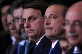 Brazil's President Jair Bolsonaro looks on during the ceremony of the 300 days of government at the Planalto Palace, in Brasilia, Brazil, Nov. 5, 2019.