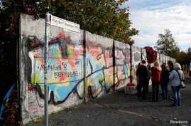 FILE - Remains of the Berlin Wall are pictured at former Bornholmer Strasse Berlin Wall border crossing point in Berlin, Germany, Oct. 18, 2019.
