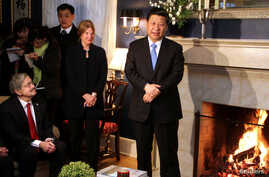 FILE - China's Vice President Xi Jinping (R) talks with area residents in the home of Roger and Sarah Lande in Muscatine, Iowa, Feb. 15, 2012.