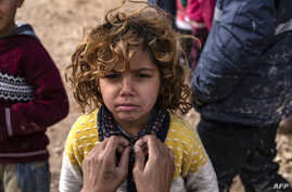 A Syrian child stands at the Washukanni camp for internally displaced persons (IDP) in the mainly Kurdish northeastern Syrian…